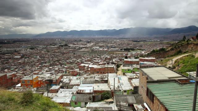 WS HA View of sprawling Ciudad Bolivar slum with mountains / Bogota, Colombia