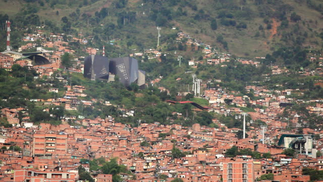 EWS HA View of sprawling slum with cable cars traveling up and down on the right side / Medellin, Colombia