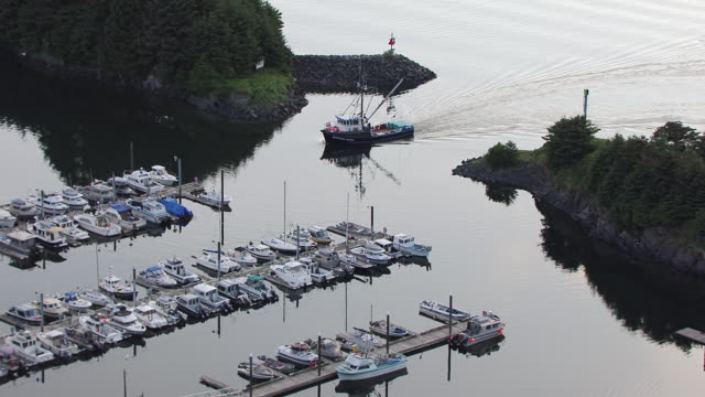 WS AERIAL ZI View of St Hermans Harbor to Northern Jaeger coming into dock / Kodiak, Alaska, United States