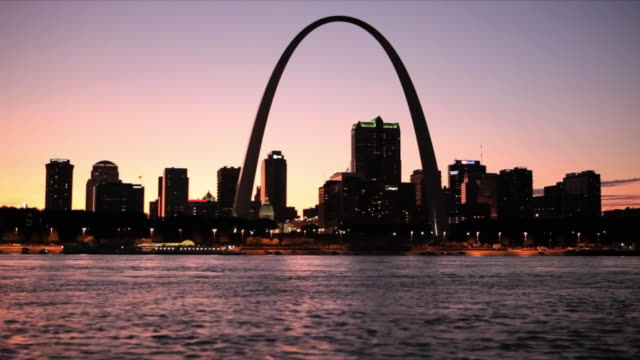 ws view of st louis skyline with mississippi river at sunset / st louis, missouri, usa  - st. louis missouri stock videos & royalty-free footage