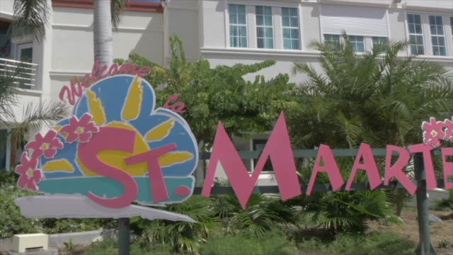 view of st. maarten sign and duty free area at cruise ship terminal, philipsburg, st. maarten, dutch antilles, west indies, caribbean, central america - tropical tree stock videos & royalty-free footage