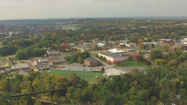 WS AERIAL View of St Mary High School campus and football field / Akron, Ohio, United States