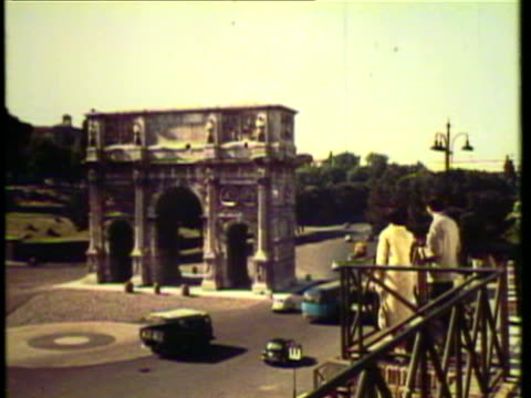 1953 WS PAN View of St Peters and grand coliseum with many other ancient ruins / Rome, Italy / AUDIO