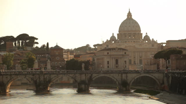 ws view of st. peters basilica and ponte sant angelo at sunset / rome, lazio, italy  - basilica stock videos and b-roll footage