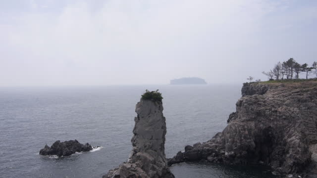 view of stack rock and cliff at the sea of oedolgae(scenic spot) - stack rock stock videos and b-roll footage