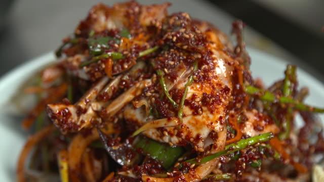 view of stacking ganjang gejang(soy sauce marinated raw crab) - marinated stock videos and b-roll footage