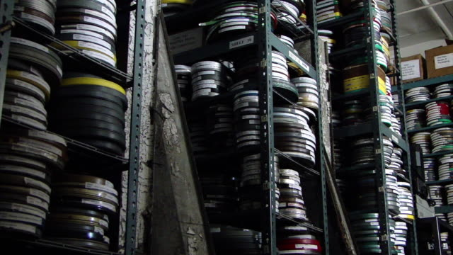 view of stacks of different films in film cans on shelves, in a film archive in san francisco, california on february 22, 2012. - film reel stock videos & royalty-free footage