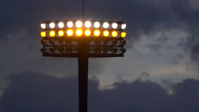 view of stadium lights at dusk - floodlight stock videos & royalty-free footage