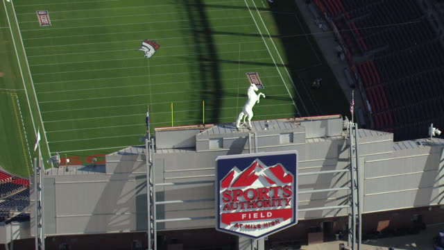 MS ZO AERIAL View of stadium sign with broncos horse statue and football field stadium / Denver, Colorado, United States