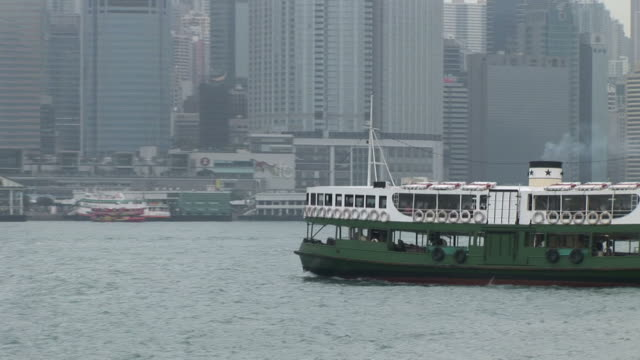 view of star ferry cruising in hong kong china - central plaza hong kong stock-videos und b-roll-filmmaterial