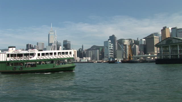 View of Star Ferry from a moving boat in Hong Kong China