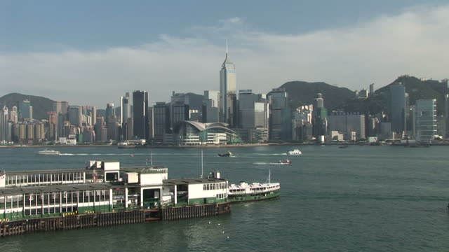 view of star ferry harbor in hong kong china - central plaza hong kong stock-videos und b-roll-filmmaterial
