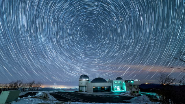 view of star field and star trail from jogyeongcheol observatory in winter - observatorium stock-videos und b-roll-filmmaterial