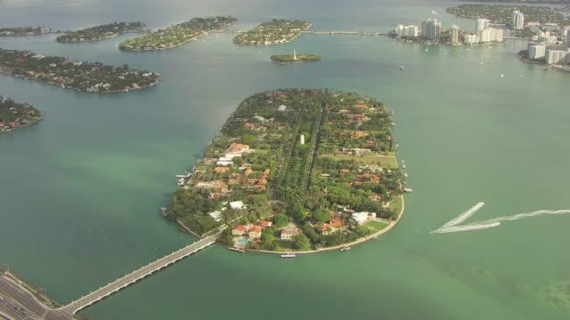 ws aerial view of star island and orbit around island / miami, florida, united states - star island stock videos & royalty-free footage