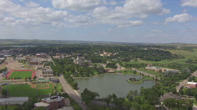 ws aerial view of state capitol building and surrounding area / pierre, south dakota, united states - south dakota stock videos and b-roll footage