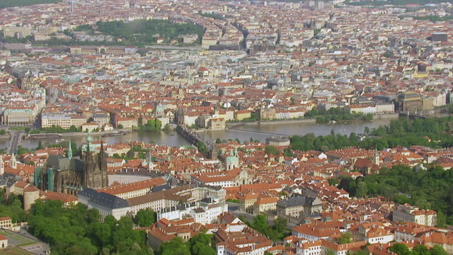 stockvideo's en b-roll-footage met ws aerial view of state capitol with roof tops / prague, czech republic - praag