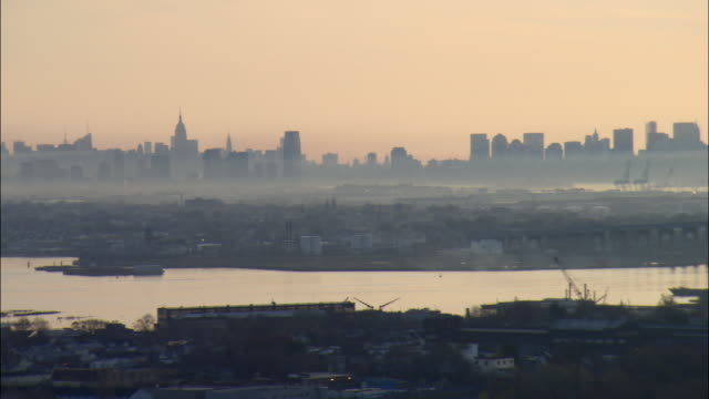 ws pan aerial view of staten island and manhattan skyline with the bayonne bridge in foreground / staten island, new york, usa - staten island stock videos and b-roll footage