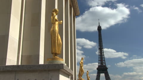 ms view of statue and eiffel tower / paris, ile-de-france, france    - female likeness stock videos & royalty-free footage