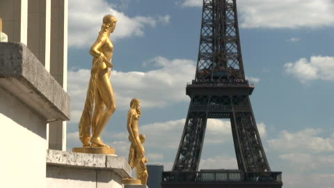 ms view of statue in front of eiffel tower / paris, ile-de-france, france    - female likeness stock videos & royalty-free footage