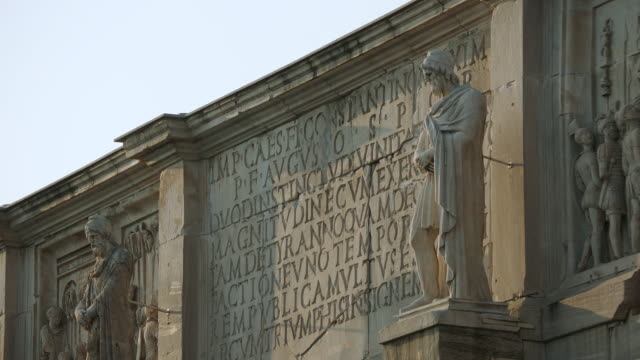 ms view of statue in front of wall / rome, italy - wand stock-videos und b-roll-filmmaterial