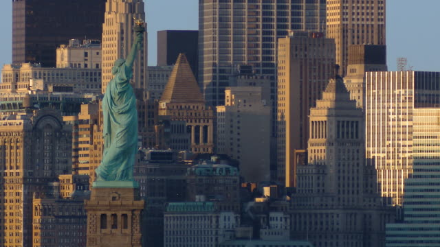 ws view of statue of liberty taken from bayonne with lower manhattan / new york city, new york, usa - statue of liberty stock videos and b-roll footage