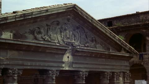 ms view of statue on entrance of church  - fronton bildbanksvideor och videomaterial från bakom kulisserna