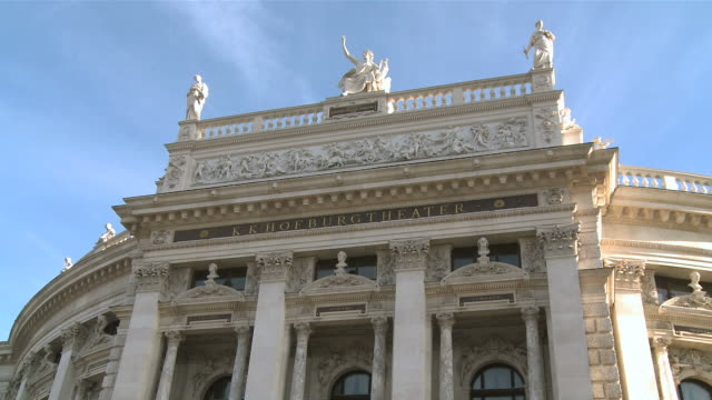 ms view of statue on top of burgtheater / vienna, austria - traditionally austrian stock videos & royalty-free footage