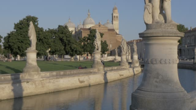 view of statues in prato della valle and santa giustina basilica visible in background, padua, veneto, italy, europe - prato stock videos and b-roll footage
