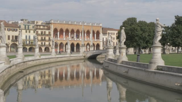 view of statues in prato della valle and town hall & culture centre, padua, veneto, italy, europe - prato stock videos and b-roll footage