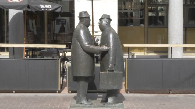 view of statues on stephen avenue/8th avenue, calgary, alberta, canada, north america - statue stock videos & royalty-free footage