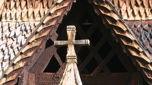 stockvideo's en b-roll-footage met cu view of stave church cross / borgund, sogn og fjordane, norway - kerk
