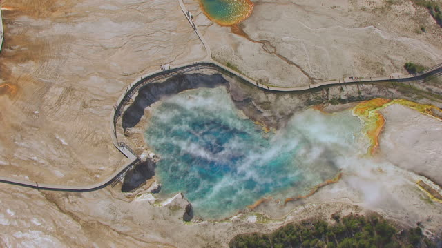 ws aerial ts ds view of steam rising over excelsior geyser crater in yellowstone national park / wyoming, united states - イエローストーン国立公園点の映像素材/bロール