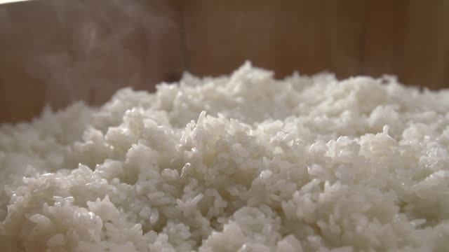 View of steamed rice on the wooden bowl