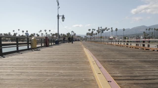 view of stearns wharf pier and beach, santa barbara, california, united states of america, north america - pier点の映像素材/bロール
