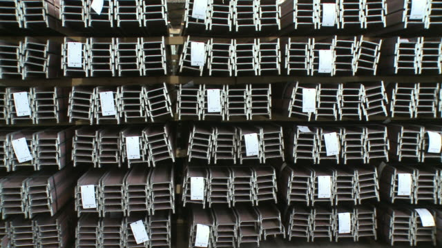 ws pan view of steel channels in store at hoesch-schwerte / schwerte, rhineland-palatinate, germany - group of objects stock videos and b-roll footage