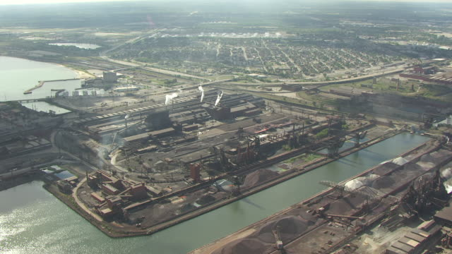 WS AERIAL POV View of steel mill and Lake Michigan / Gary, Indiana, United States