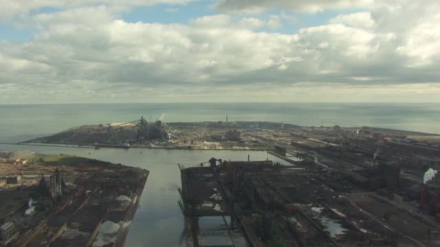 WS AERIAL POV View of steel mill with Lake Michigan / Gary, Indiana, United States