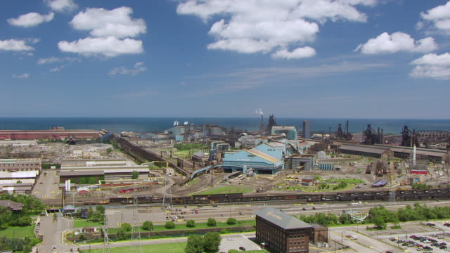 vídeos y material grabado en eventos de stock de ws aerial pov view of steel mills in front of sea of uss steel gary works / lake county, gary, indiana, united states - indiana
