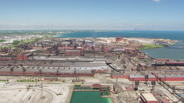 WS AERIAL POV View of steel mills in on edge of Lake Michigan / Lake County, Gary, Indiana, United States