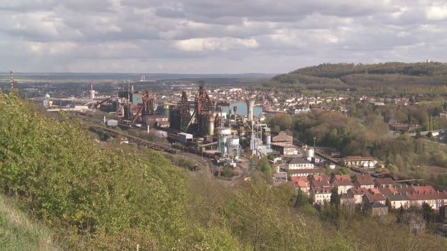ws view of steelworks factory in town / uckange, lorraine, france - lorraine stock videos & royalty-free footage