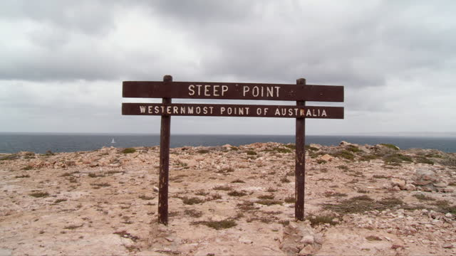 ws view of steep point sign board with sea in background / shark bay, western australia, australia - shark bay stock videos & royalty-free footage