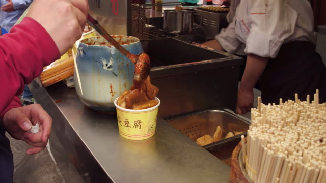 A view of stinky tofu in famous Wangfujing Snack Street on May 4 2017 in Beijing China Wangfujing is a main business street for tourism next to the...