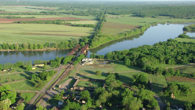 ws aerial view of stockade with river  / fort gibson, oklahoma, united states - oklahoma stock-videos und b-roll-filmmaterial