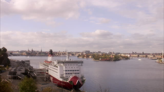 view of stockholm with ferry in the foreground sweden. - ferry stock videos & royalty-free footage