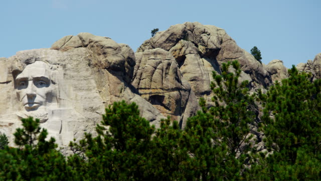 view of stone carved presidents mount rushmore usa - mt rushmore national monument stock videos and b-roll footage