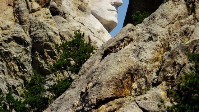 view of stone carved presidents mount rushmore usa - south dakota stock-videos und b-roll-filmmaterial