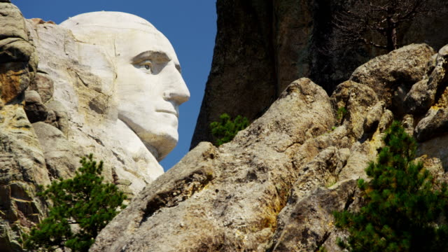 view of stone carved presidents mount rushmore usa - george washington stock-videos und b-roll-filmmaterial