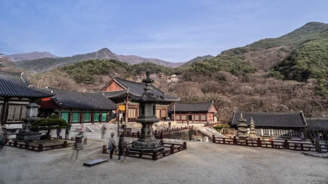 view of stone lantern at daeungjeon hall of hwaeomsa temple(national cultural heritages) in guryegun, jeollanam-do, south korea - jeollanam do stock videos & royalty-free footage