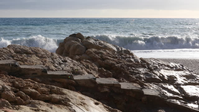 View of stone steps as waves crash behind