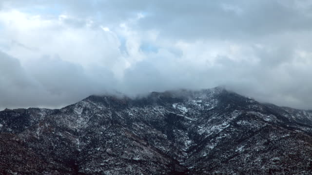WS T/L View of storm clouds moving over mountain tops / Tucson, Arizona, United States